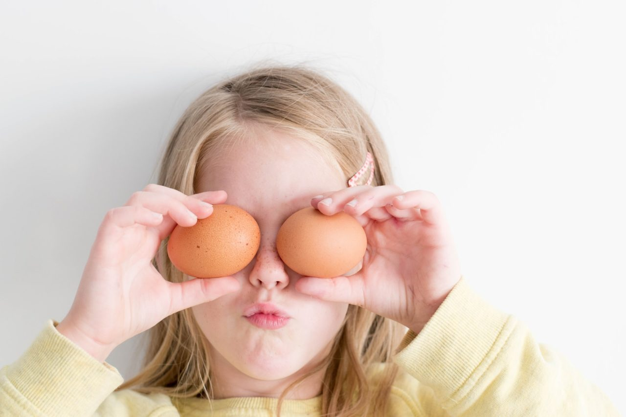 Female Child holding Brown Eggs